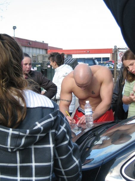 Signing autographs after the pull.